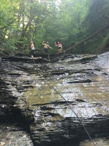 Caroline and friends climbing waterfall - jpeg