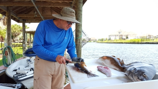 Grandfather filleting fish catch - 20150607_142541